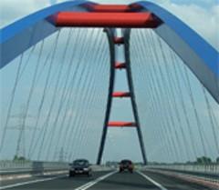 Cars passing a bridge
