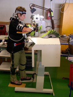 Sewing operative working in standing position at the modified workplace