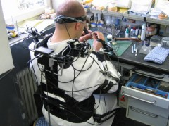 Dental technician at his workplace, seen from behind