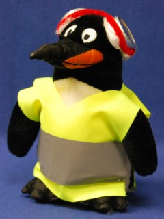 Stuffed penguin with warning vest and hearing protection