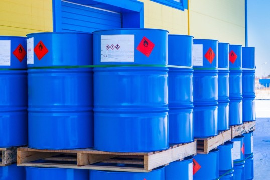 Photo: Blue barrels stacked on pallets