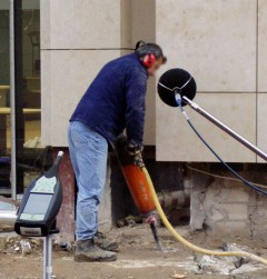 Worker handling a demolition hammer