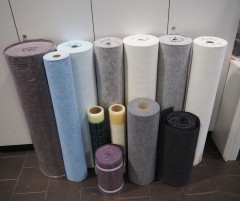A dozen rolls of felt, plastic and other materials