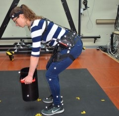 Woman with hip belt / harness lifting a load
