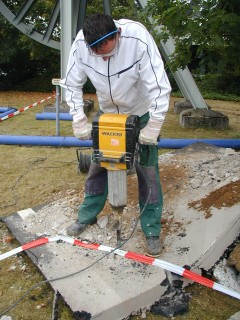 Test person working with a demolition hammer