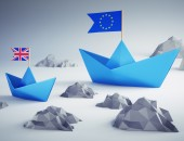 Picture of two paper boats - one with a European flag and the other with a British flag