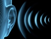 Grafik: Ohr und Schallwellen
