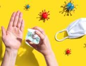 Hände mit Desinfektionsspray