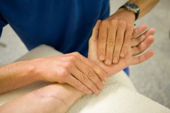 Hand of a patient is therapeutically treated physio